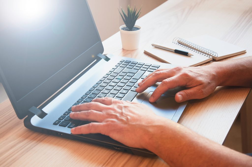 Male,Hands,Working,On,Modern,Laptop,-,Working,At,Home